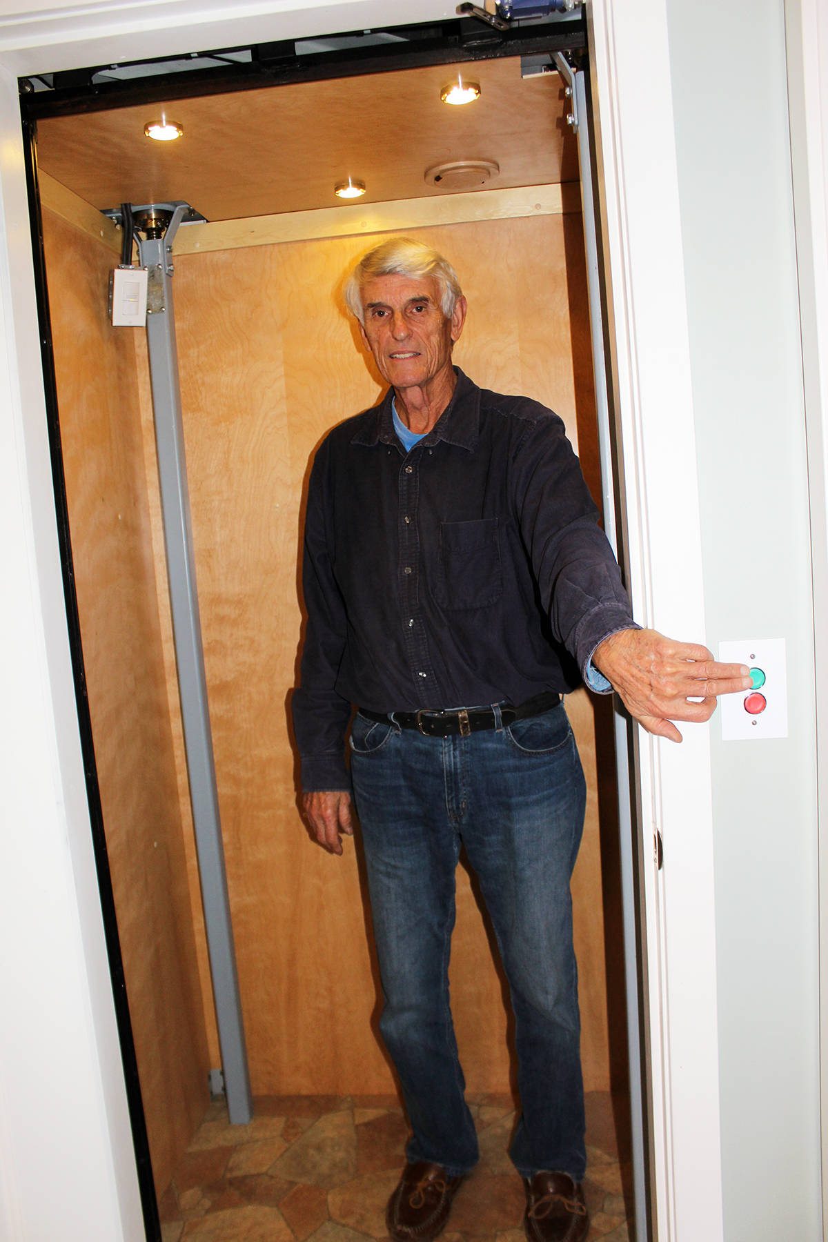 Pushing the right buttons sends Bob Higgins' elevator into operation. (Photo by Don Bodger)